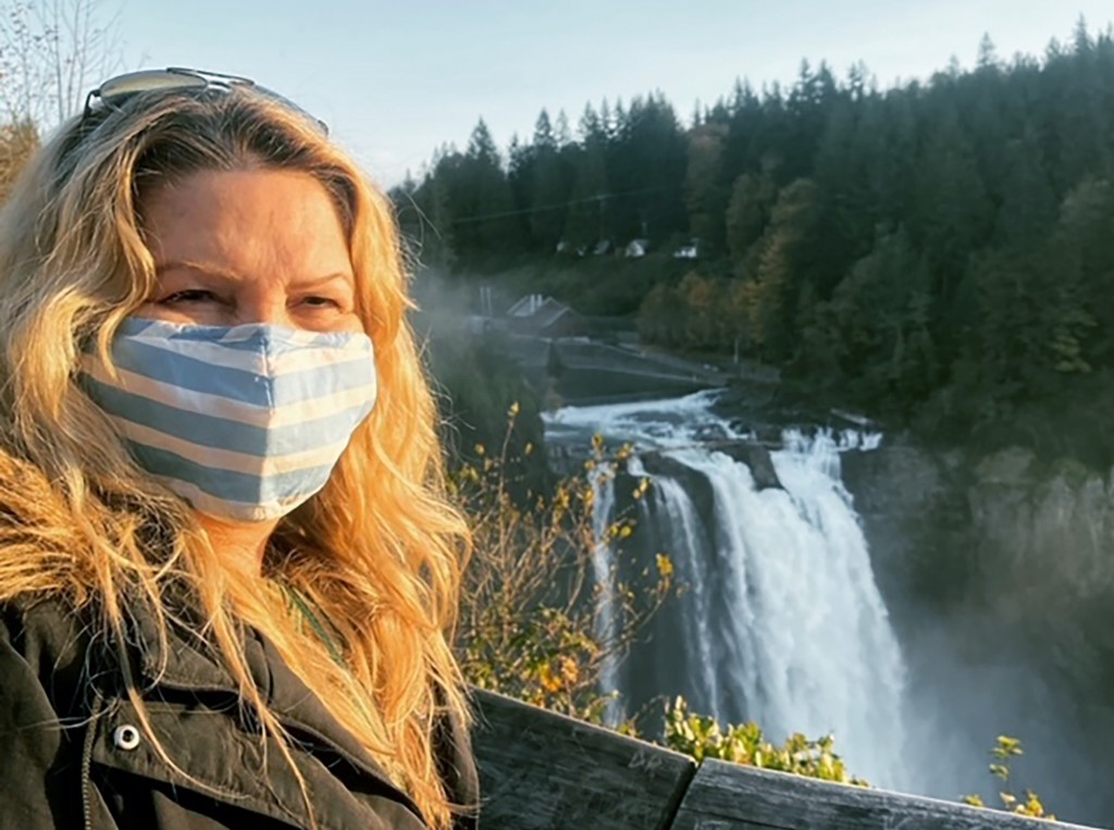 In this photo provided by Zana Cooper, Cooper of Murrieta, Calif., poses for a selfie at Snoqualmie Falls in Wash., on Oct. 25, 2020. Cooper tested po...