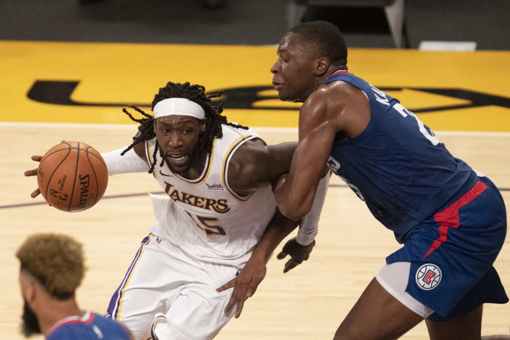 Los Angeles Lakers forward Montrezl Harrell, left, drives toward the basket as Los Angeles Clippers forward Mfiondu Kabengele defends during the secon...