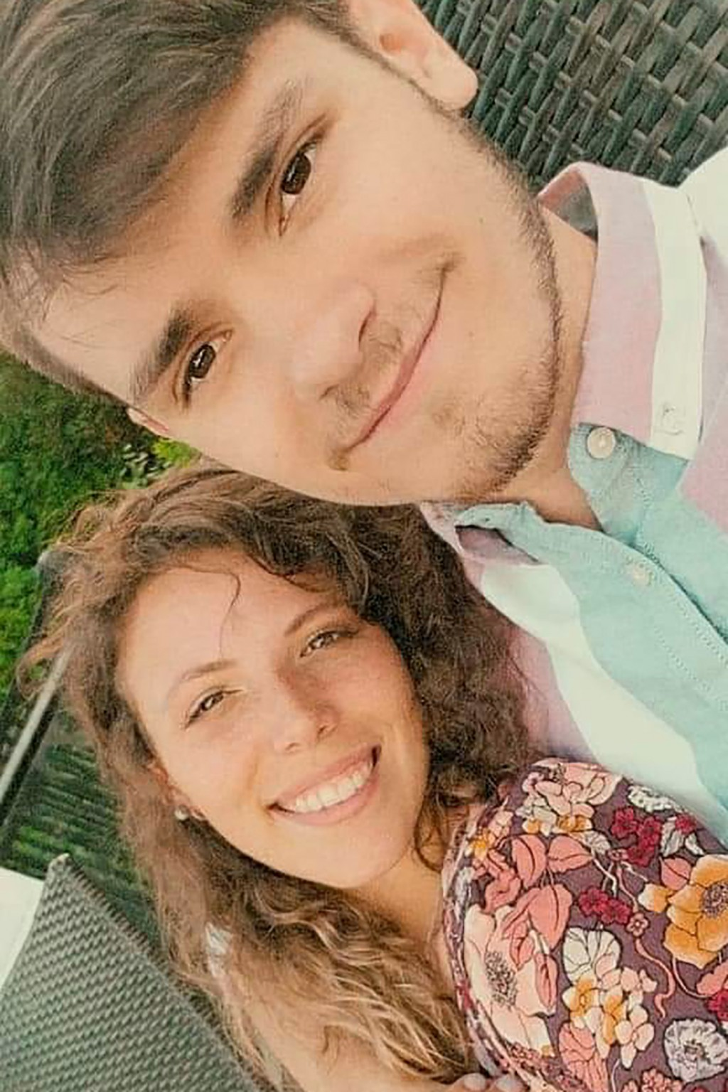 In this image provided by Harry Neidig, he and his wife, Ashley Neidig, who both tested positive for COVID-19, pose for a selfie on June 24, 2020, in ...