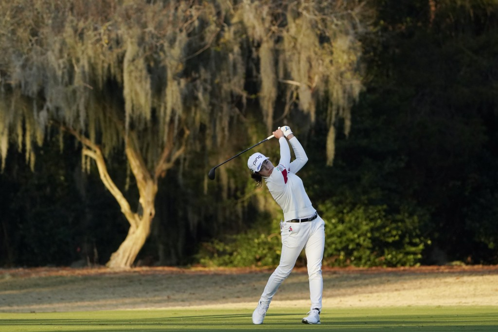 Hinako Shibuno, of Japan, hits to the 18th green during the third round of the U.S. Women's Open golf tournament, Saturday, Dec. 12, 2020, in Houston....