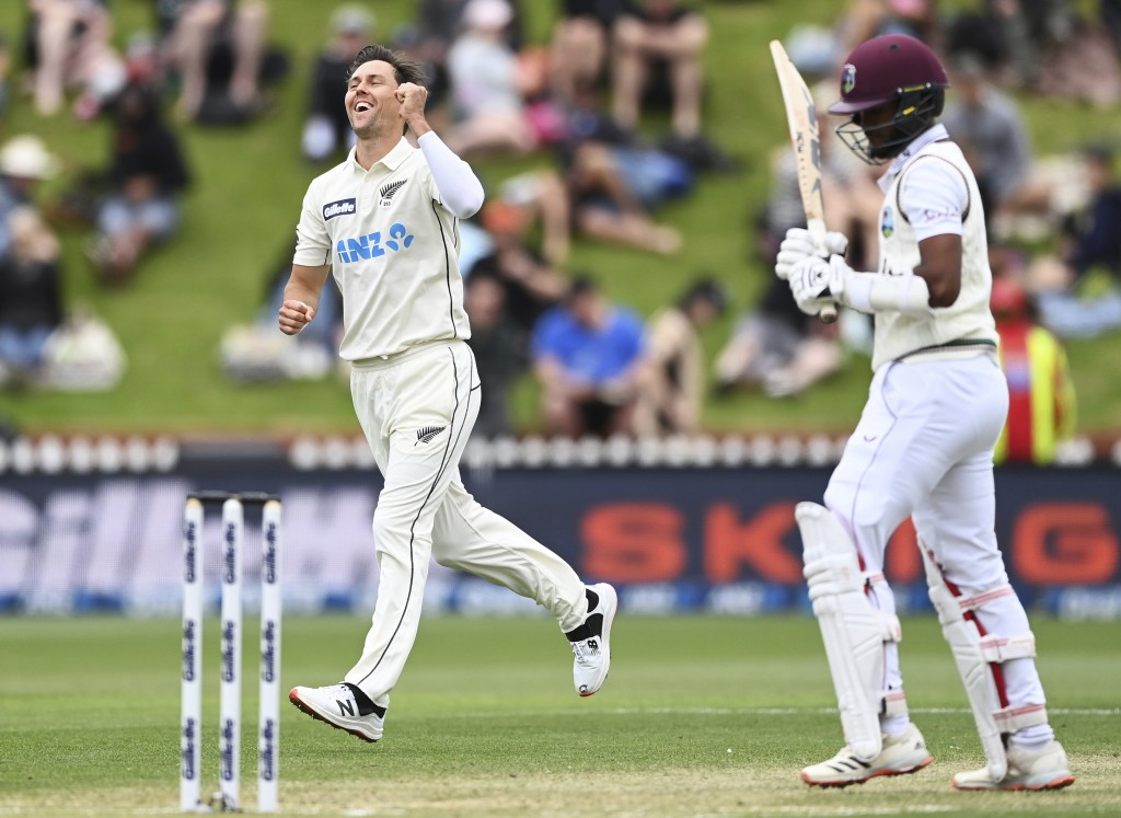 New Zealand's bowler Trent Boult, left, celebrates the wicket of West Indies' Kraigg Brathwaite, right, during play on the third day of their second c...