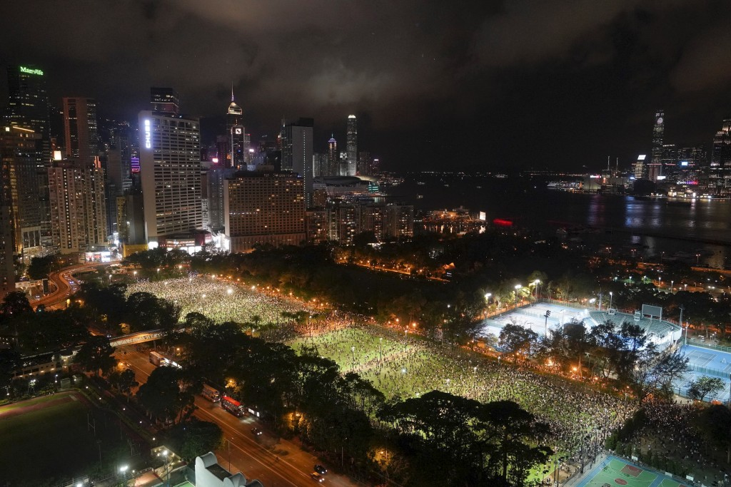 People gather for a vigil for the victims of the 1989 Tiananmen Square Massacre at Victoria Park in Causeway Bay, Hong Kong, Thursday, June 4, 2020, d...