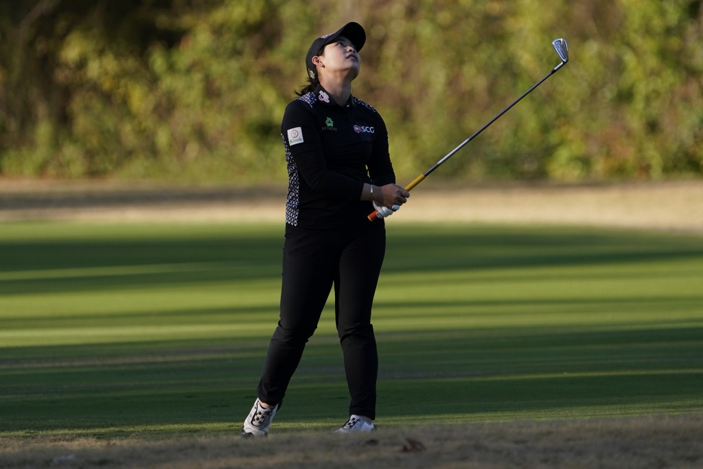 Moriya Jutanugarn, of Thailand, reacts to her second shot on the 17th hole during the third round of the U.S. Women's Open golf tournament, Saturday, ...