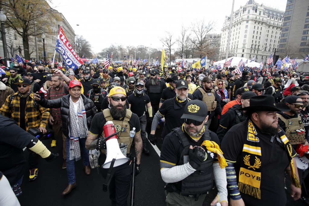 Supporters of President Donald Trump who are wearing attire associated with the Proud Boys attend a rally at Freedom Plaza, Saturday, Dec. 12, 2020, i...
