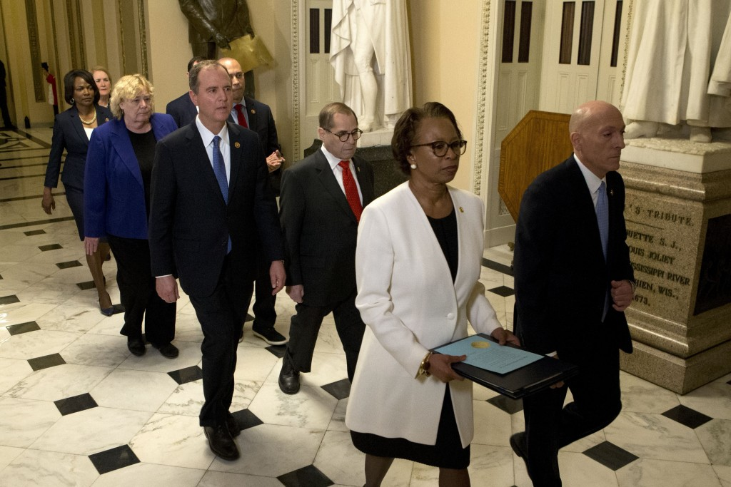 House Sergeant at Arms Paul Irving and Clerk of the House Cheryl Johnson deliver the articles of impeachment against President Donald Trump to Secreta...