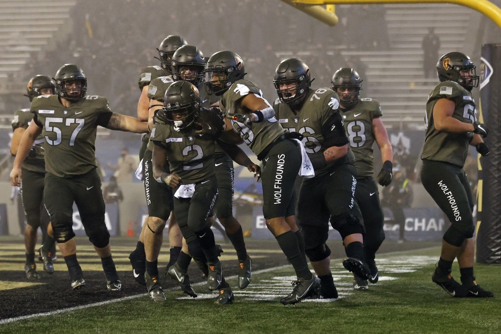 Army quarterback Tyhier Tyler celebrates after scoring a touchdown during the second half of an NCAA college football game Saturday, Dec. 12, 2020, in...