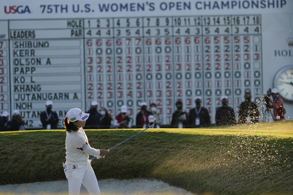 Hinako Shibuno, of Japan, hits out of tghe bunker on the 18th hole during the third round of the U.S. Women's Open golf tournament, Saturday, Dec. 12,...