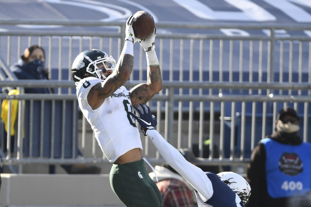 Michigan State wide receiver Jalen Nailor (8) catches a touchdown pass over Penn State cornerback Marquis Wilson (8) during the second quarter of an N...