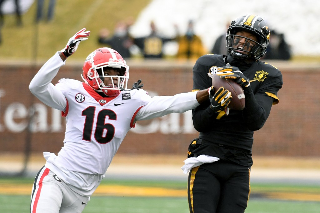 Missouri wide receiver Damon Hazelton, right, catches a pass as Georgia defensive back Lewis Cine (16) defends during the second half of an NCAA colle...