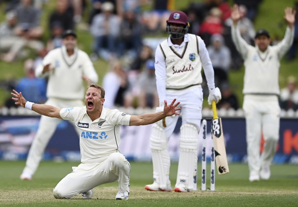 New Zealand's Neil Wagner, second left, appeals unsuccessfully for a LBW decision on the West Indies' Shamarh Brooks, second right, on the third day o...
