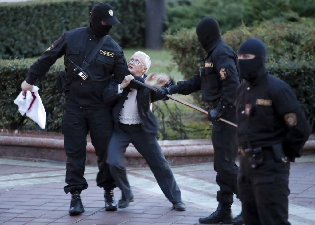 Opposition activist Nina Baginskaya, 73, center, struggles with police during a Belarusian opposition supporters rally at Independence Square in Minsk...