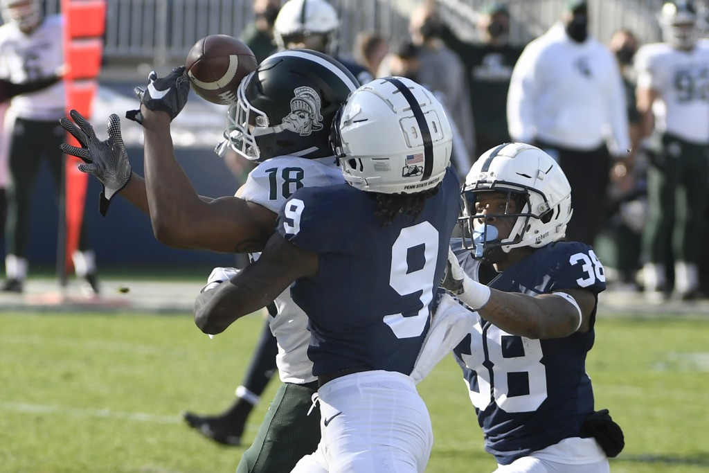 Michigan State wide receiver Tre'Von Morgan (18) catches a touchdown pass over Penn State cornerback Joey Porter Jr. (9) during the second quarter of ...