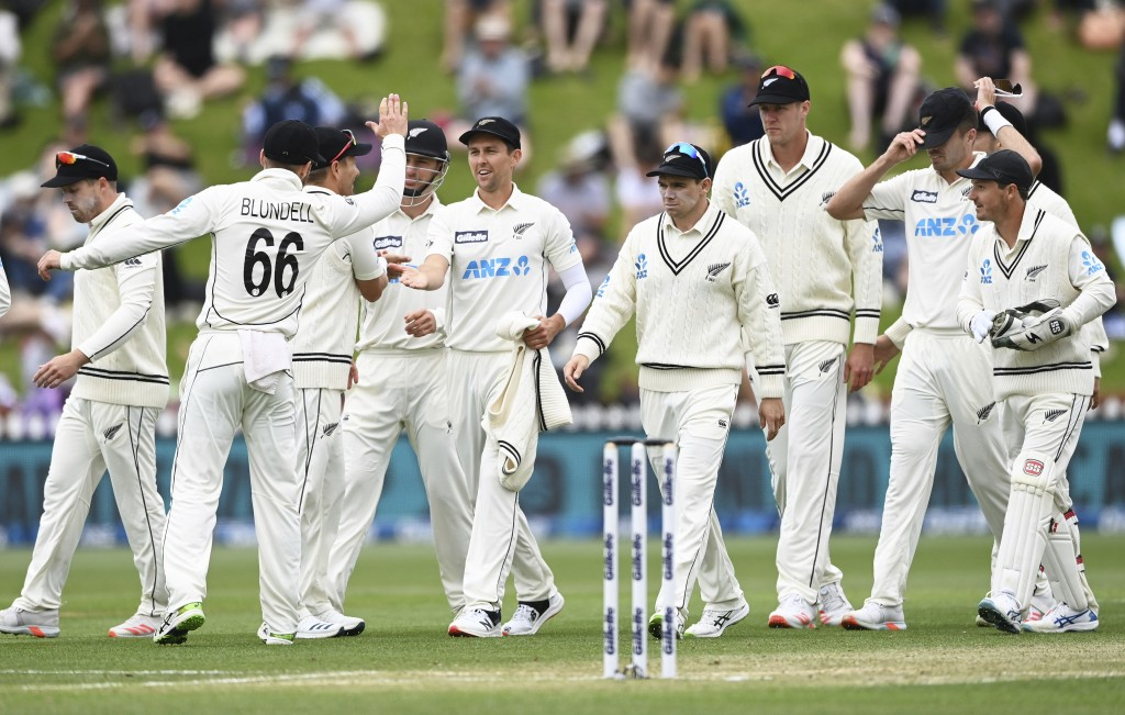 New Zealand players celebrate after dismissing the West Indies for 131 runs in their first innings during play on the third day of their second cricke...