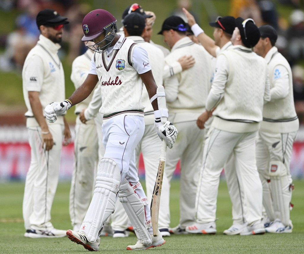 West Indies' batsman Kraigg Brathwaite walks off after being caught by New Zealand's Will Young during play on the third day of their second cricket t...