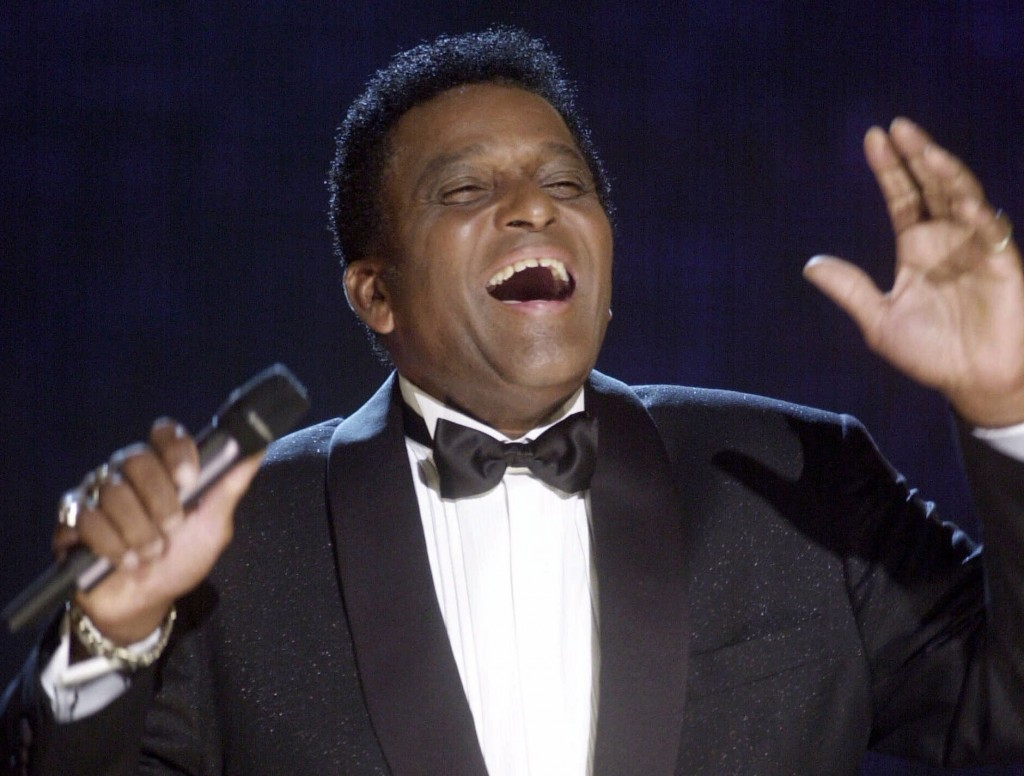 CORRECTS FIRST NAME TO CHARLEY, INSTEAD OF CHARLIE FILE - In this Oct. 4, 2000, file photo, Charley Pride performs during his induction into the Count...