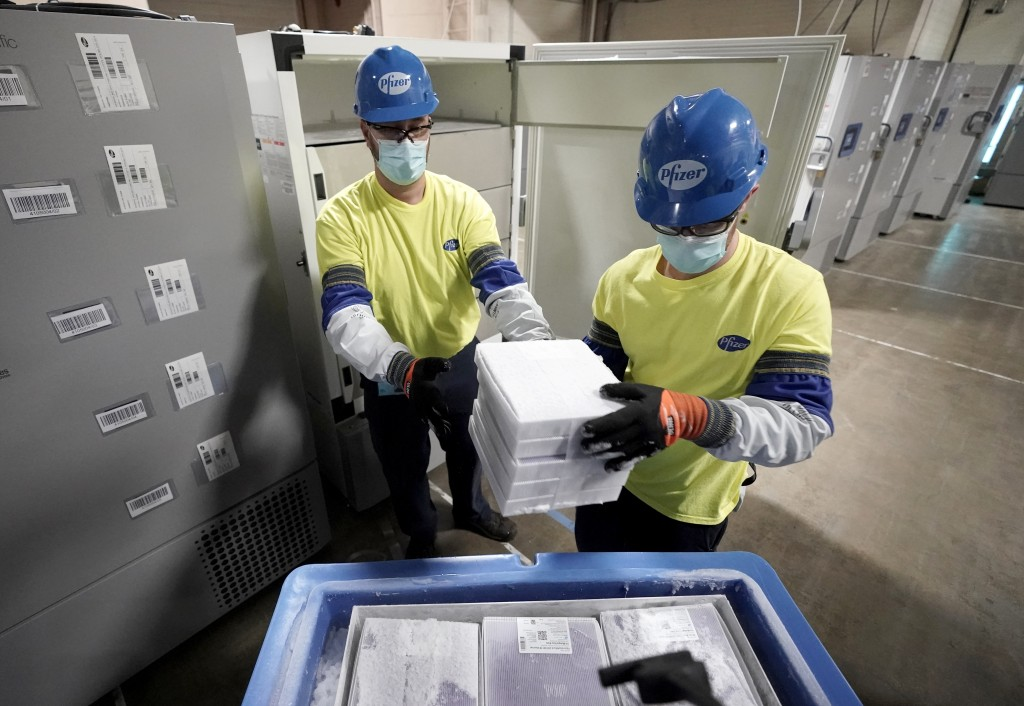 Boxes containing the Pfizer-BioNTech COVID-19 vaccine are prepared to be shipped at the Pfizer Global Supply Kalamazoo manufacturing plant in Portage,...