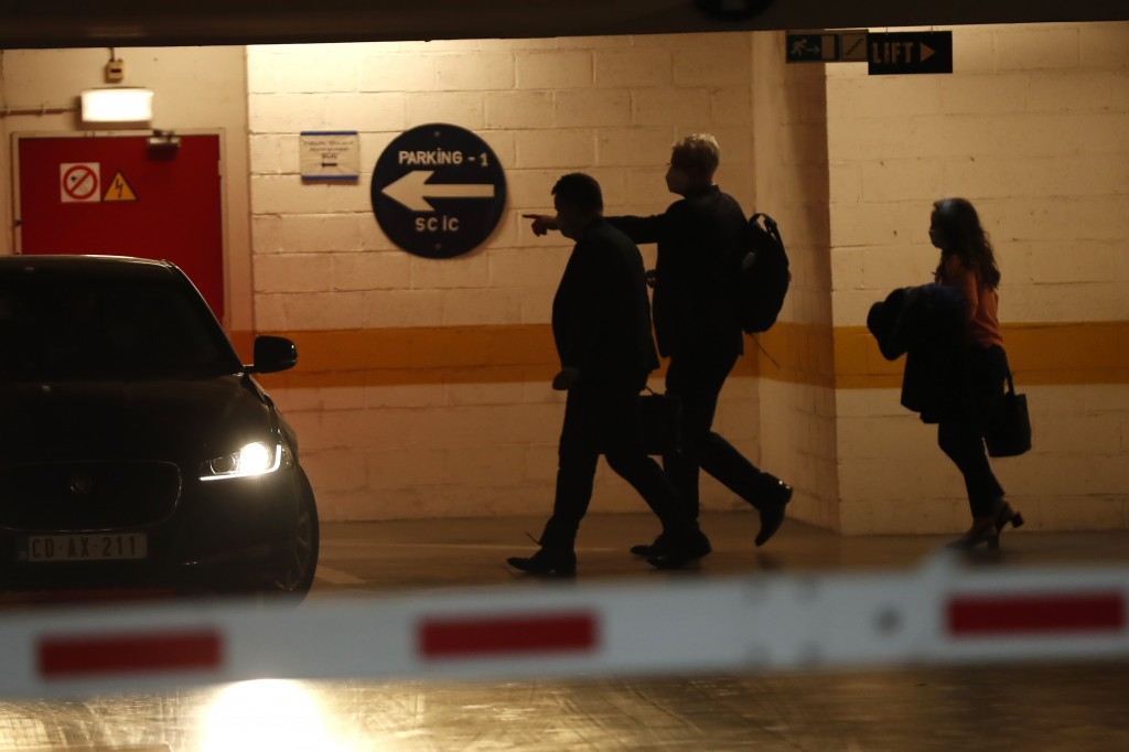 Britain's chief negotiator David Frost, left, in an underground garage leaves after a meeting with European Commission's Head of Task Force for Relati...