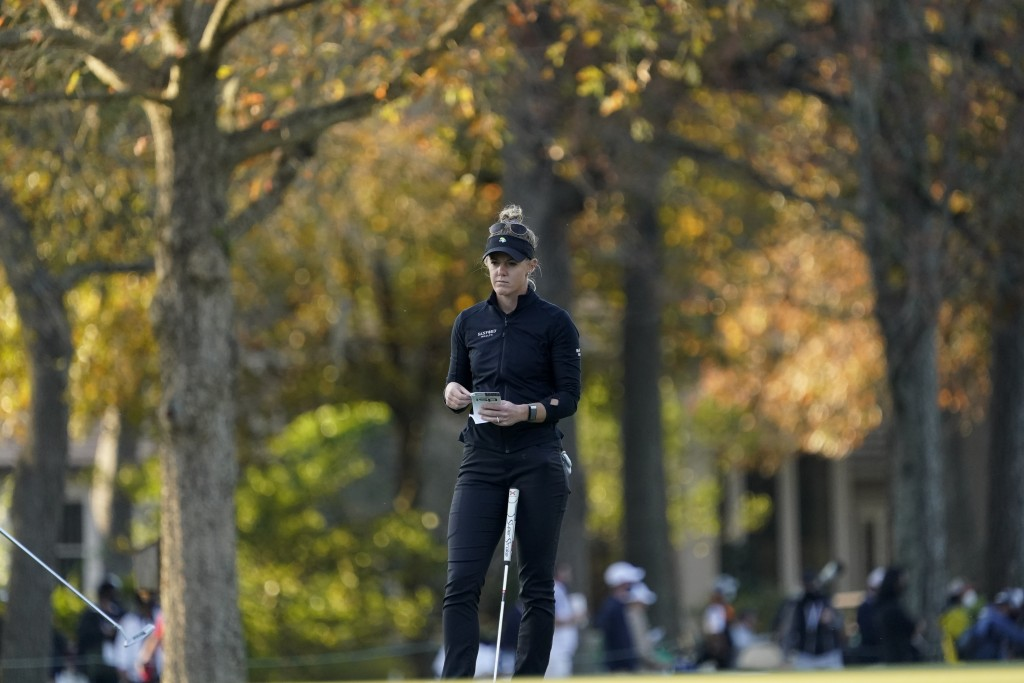 Amy Olson checks her yardage book on the 17th hole during the third round of the U.S. Women's Open golf tournament, Saturday, Dec. 12, 2020, in Housto...