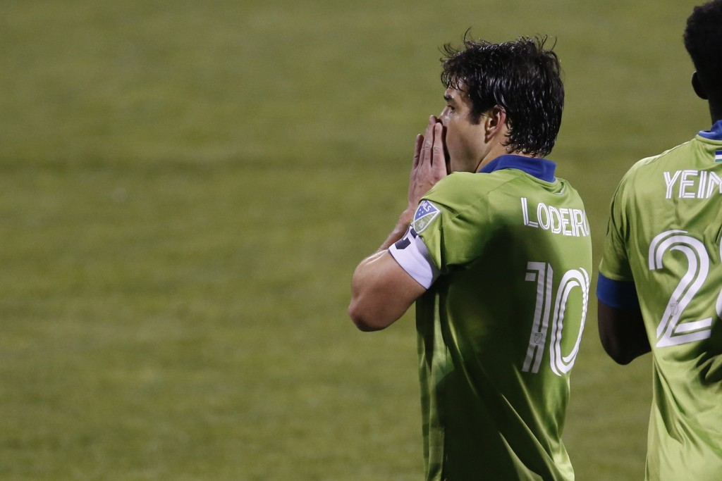 Seattle Sounders' Nicolas Lodeir reacts to missing a shot against the Columbus Crew during the second half of the MLS Cup championship game Saturday, ...