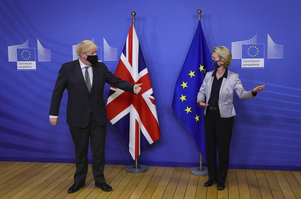 Britain's Prime Minister Boris Johnson is welcomed for a dinner with European Commission president Ursula von der Leyen, right, in Brussels, Belgium, ...