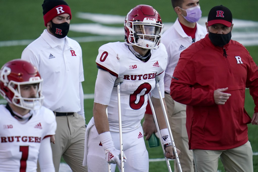 Rutgers quarterback Noah Vedral (0) walks with crutches on the sideline during the second half of an NCAA college football game against Maryland, Satu...