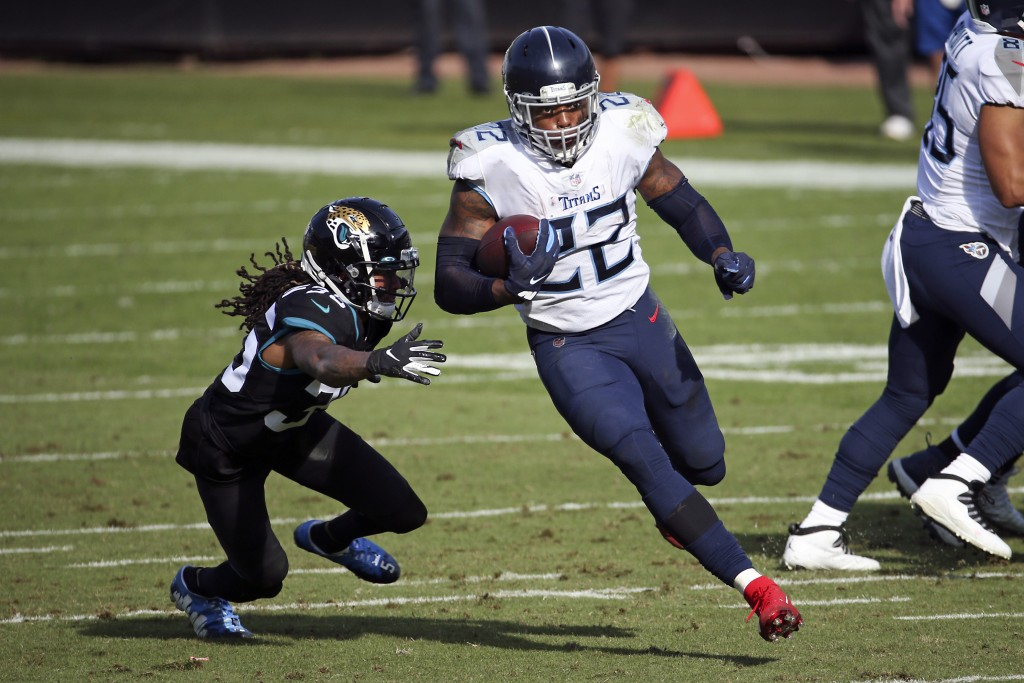 Tennessee Titans running back Derrick Henry (22) goes past Jacksonville Jaguars cornerback Sidney Jones for a 36-yard touchdown during the first half ...