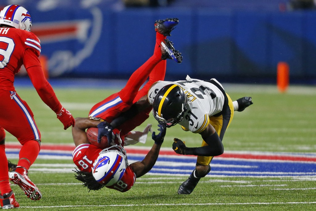 Buffalo Bills wide receiver Andre Roberts (18) is tackled by Pittsburgh Steelers cornerback Justin Layne (31) during the second half of an NFL footbal...