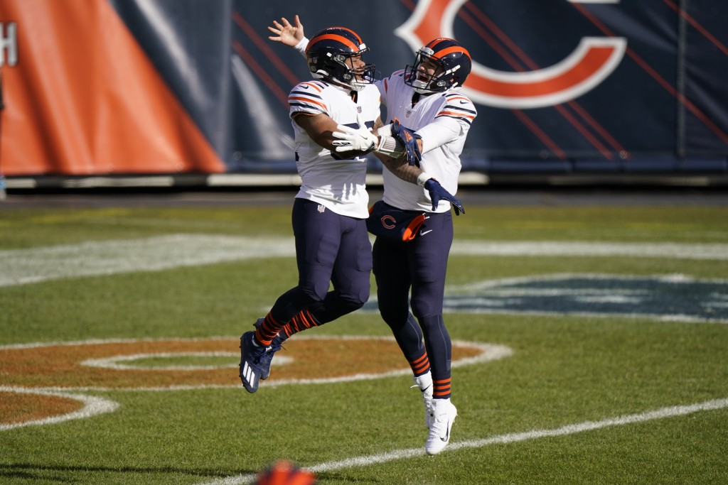 Chicago Bears running back David Montgomery (32) celebrates a touchdown run with quarterback Mitchell Trubisky (10) during the first half of an NFL fo...