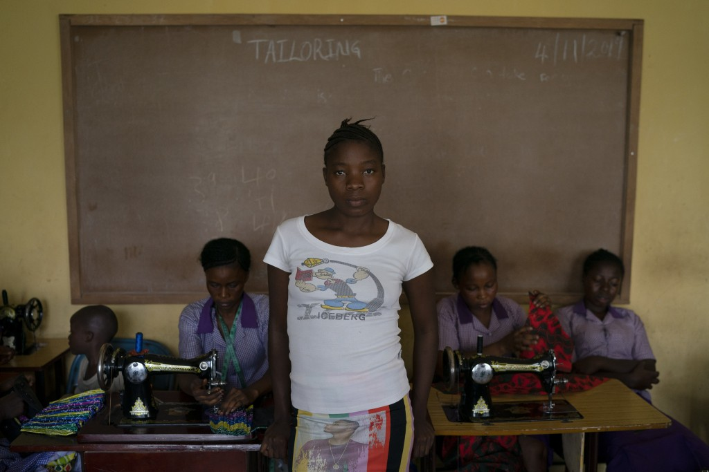 "Naomi poses for a portrait at a tailoring classroom in the district of Kono, Sierra Leone, Monday, Nov. 23, 2020. ""My family are farmers and don't hav..."