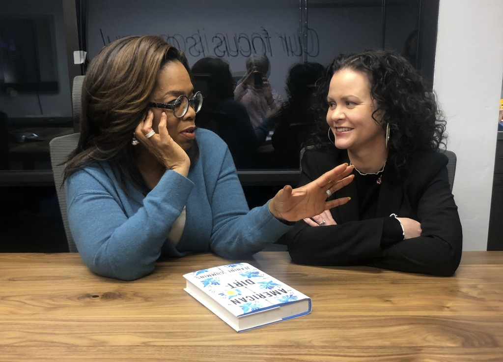 """FILE - In this Feb. 13, 2020 file photo, Oprah Winfrey, left, and """"American Dirt"""" author Jeanine Cummins appear in a conference room just above Modern..."""