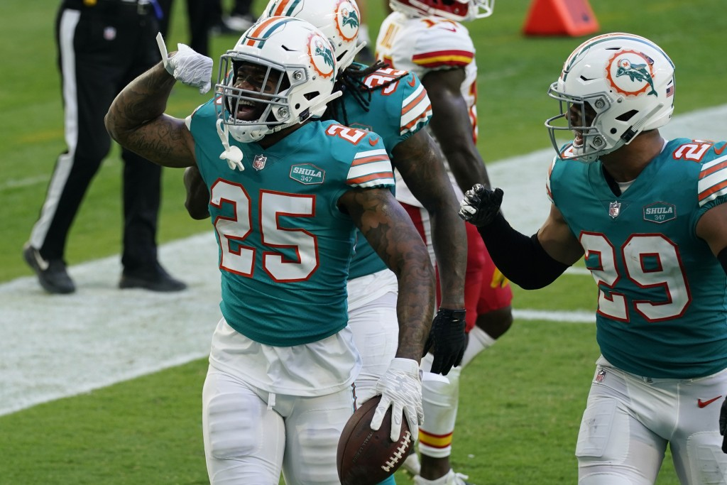 Miami Dolphins cornerback Xavien Howard (25) celebrates after intercepting a pass during the second half of an NFL football game against the Kansas Ci...