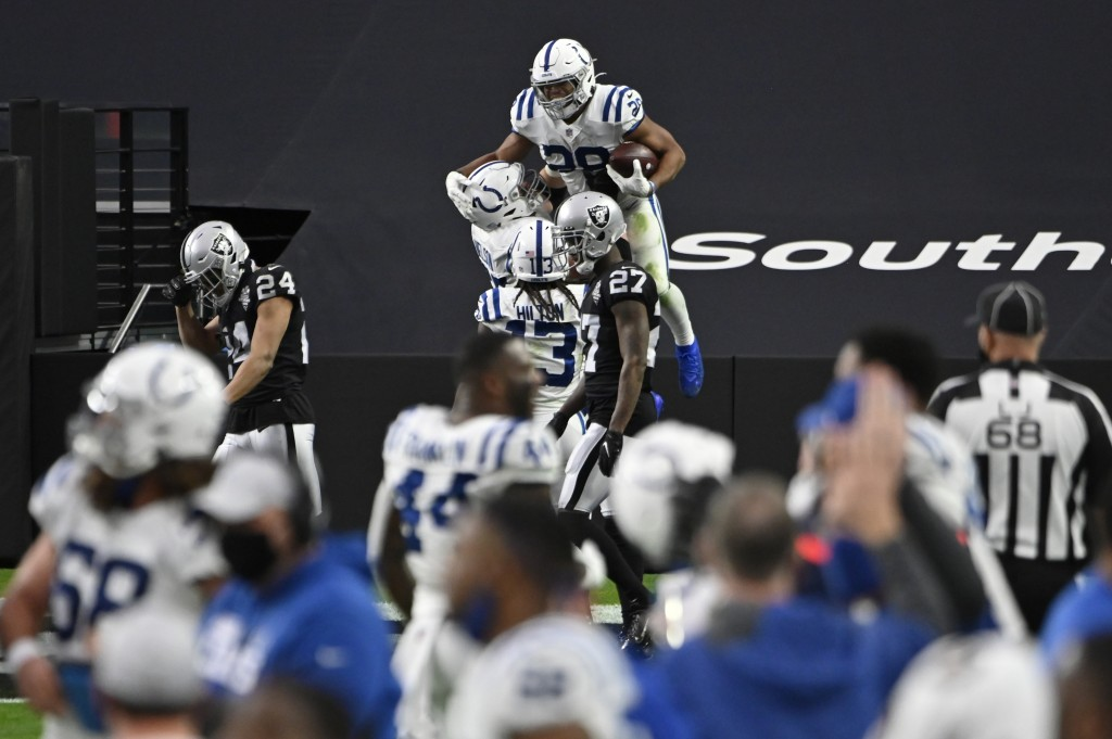 Indianapolis Colts running back Jonathan Taylor (28) celebrates after scoring a touchdown against the Las Vegas Raiders during the second half of an N...