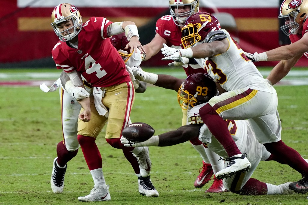 Washington Football Team defensive tackle Jonathan Allen (93) causes San Francisco 49ers quarterback Nick Mullens (4) to fumble the football during th...