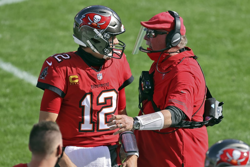 Tampa Bay Buccaneers head coach Bruce Arians congratulates quarterback Tom Brady (12) after a touchdown pass to wide receiver Scott Miller (10) during...