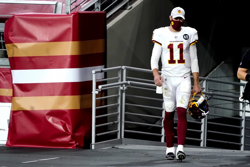 Washington Football Team quarterback Alex Smith (11) walks to the field for the start of the second half of an NFL football game against the San Franc...