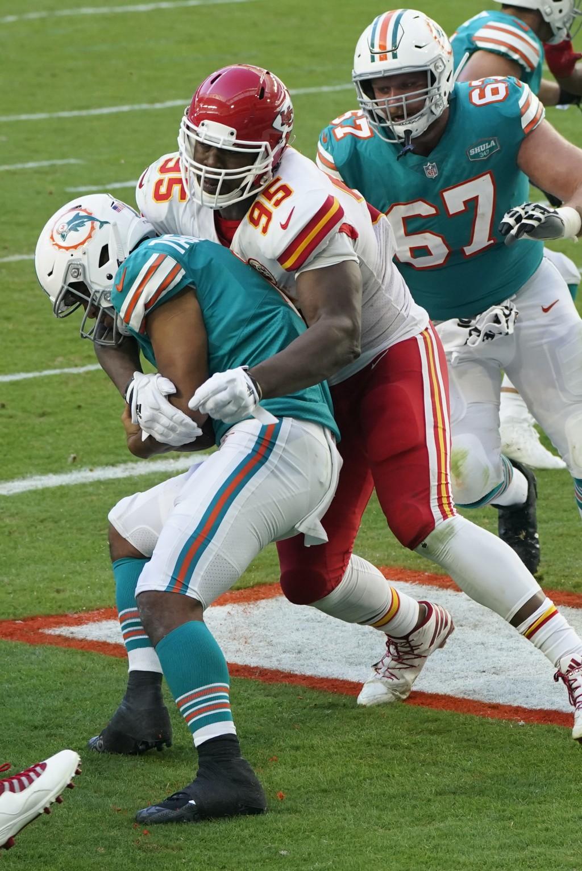 Kansas City Chiefs defensive tackle Chris Jones (95) sacks Miami Dolphins quarterback Tua Tagovailoa (1) in the endzone for a safety, during the secon...