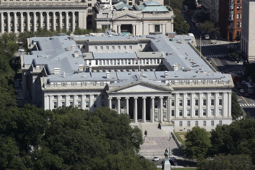 FILE - The U.S. Treasury Department building viewed from the Washington Monument, Wednesday, Sept. 18, 2019, in Washington. Hackers got into computers...