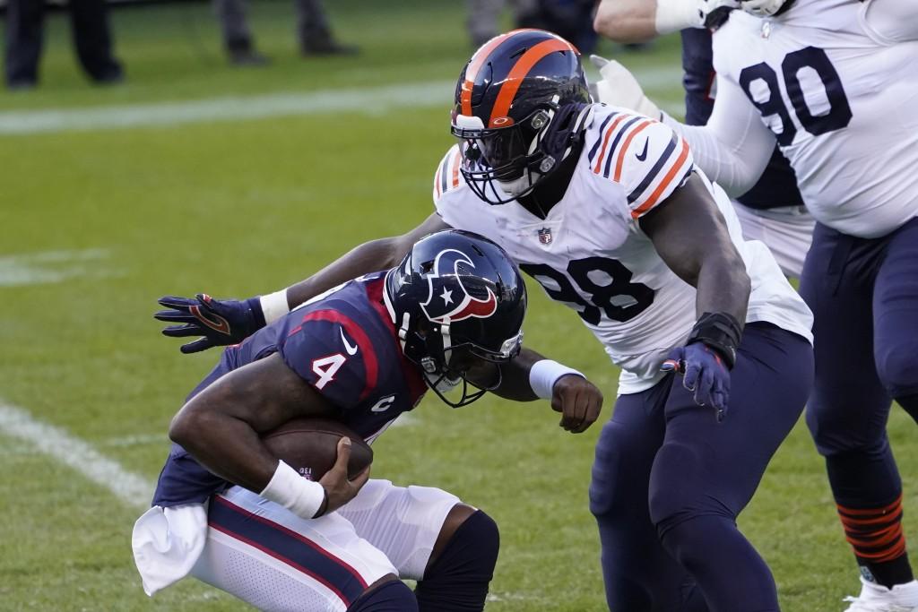 Chicago Bears' Bilal Nichols (98) sacks Houston Texans quarterback Deshaun Watson (4) during the first half of an NFL football game, Sunday, Dec. 13, ...