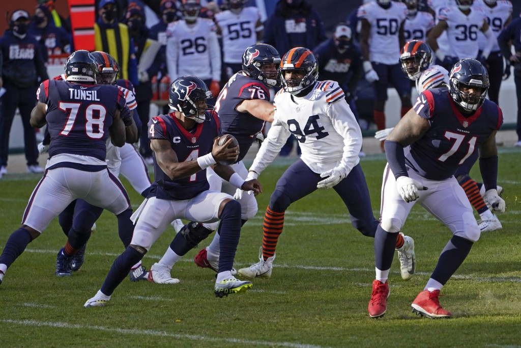 Houston Texans quarterback Deshaun Watson (4) is pressured by Chicago Bears' Robert Quinn (94) during the first half of an NFL football game, Sunday, ...
