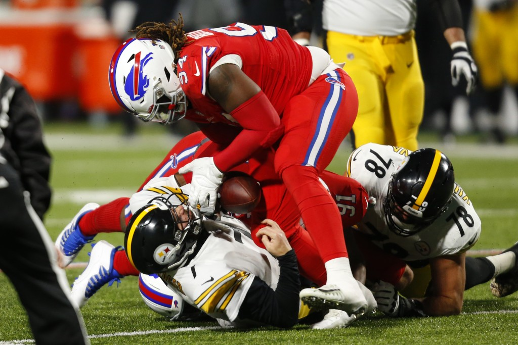 Pittsburgh Steelers quarterback Ben Roethlisberger (7) fumbles the ball as he is sacked by Buffalo Bills defensive tackle Ed Oliver (91) and Vernon Bu...