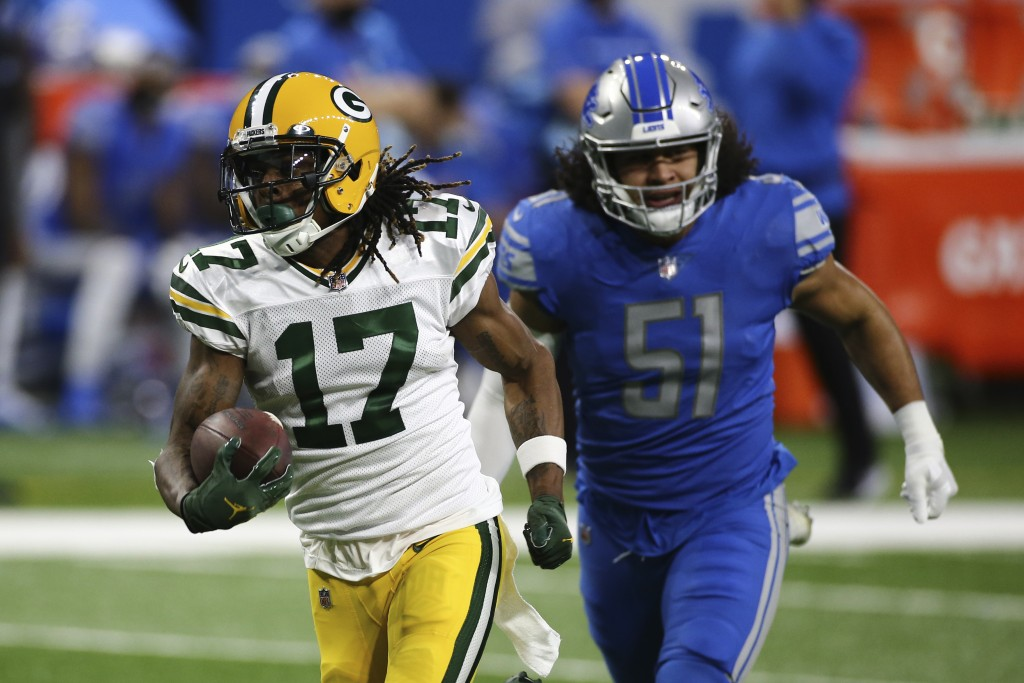 Green Bay Packers wide receiver Davante Adams (17) pulls away from Detroit Lions outside linebacker Jahlani Tavai (51) for a touchdown during the firs...