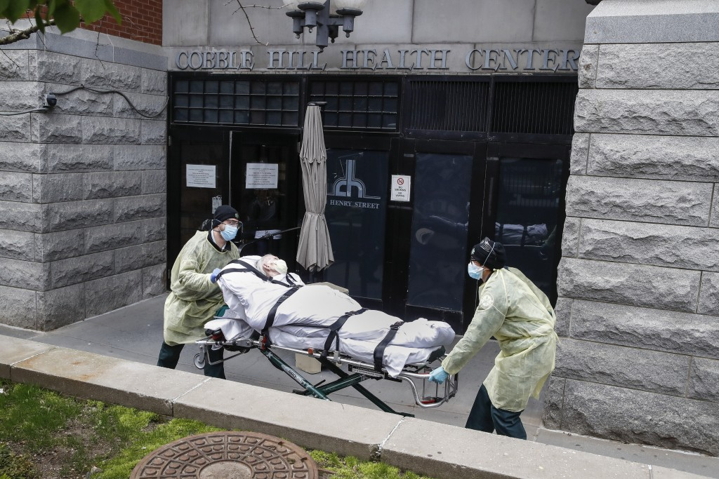 FILE - In this Friday, April 17, 2020 file photo, a patient is wheeled out of the Cobble Hill Health Center nursing home by emergency medical workers ...