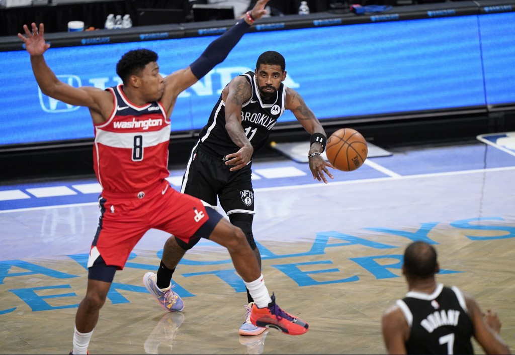 Brooklyn Nets guard Kyrie Irving (11) passes to Brooklyn Nets forward Kevin Durant (7) as Washington Wizards forward Rui Hachimura (8) defends Irving ...