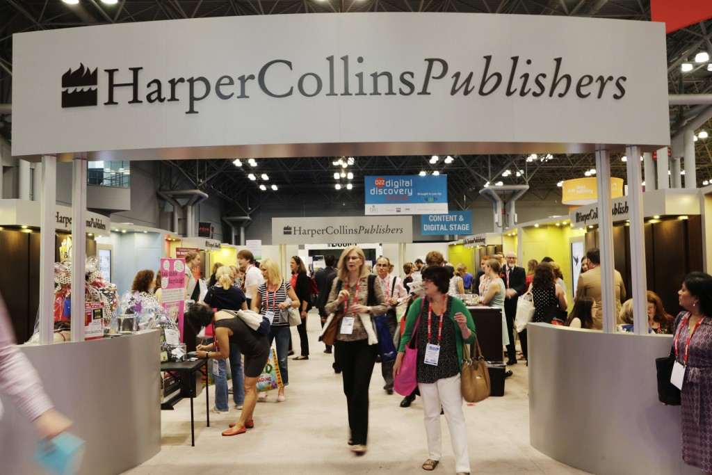 FILE - In this May 28, 2015 file photo, attendees at BookExpo America visit the HarperCollins Publishers booth in New York. The annual publishing conv...