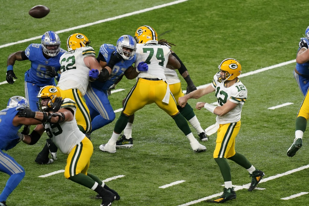 Green Bay Packers quarterback Aaron Rodgers (12) throws during the first half of an NFL football game against the Detroit Lions, Sunday, Dec. 13, 2020...