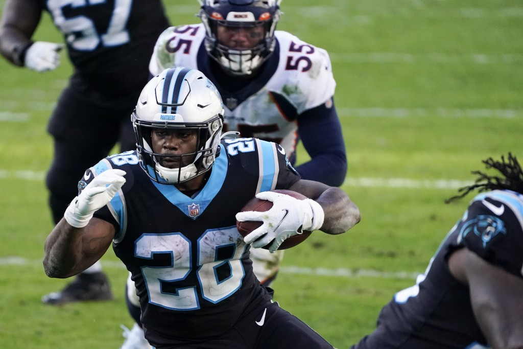 Carolina Panthers running back Mike Davis scores against the Denver Broncos during the second half of an NFL football game Sunday, Dec. 13, 2020, in C...