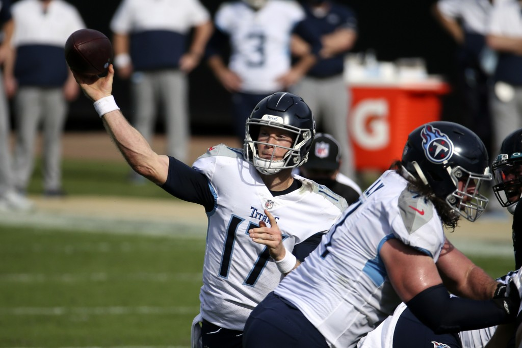 Tennessee Titans quarterback Ryan Tannehill throws a pass against the Jacksonville Jaguars during the first half of an NFL football game, Sunday, Dec....