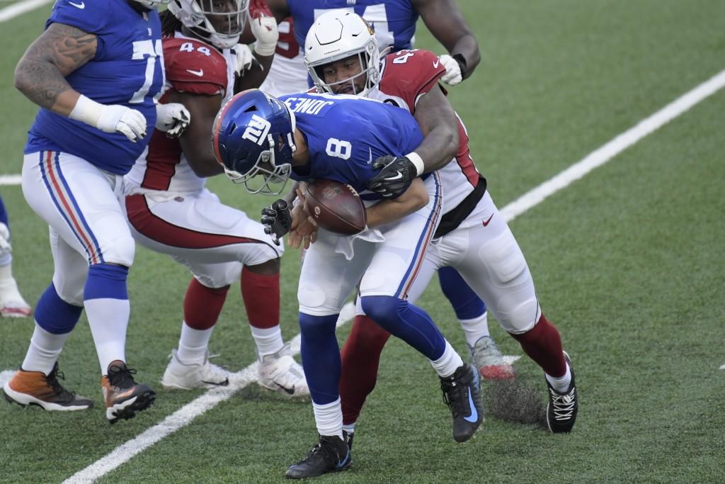 Arizona Cardinals' Haason Reddick, right, knocks the ball loose as he tackled New York Giants quarterback Daniel Jones during the first half of an NFL...