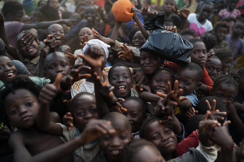 Chidren pose for a photo in Komao village, on the outskirts of Koidu, district of Kono, Sierra Leone, Sunday, Nov. 22, 2020. (AP Photo/Leo Correa)