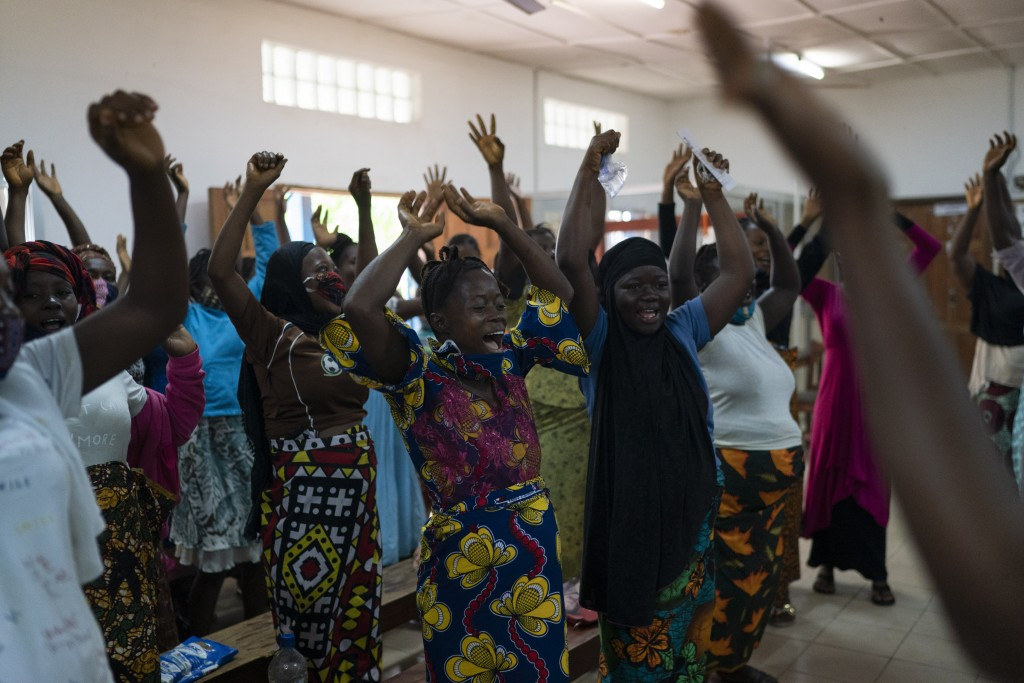 Pregnant women sing and dance before being assisted in a health unit where several women look for assistance with prenatal care in Koidu, district of ...